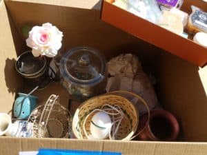 box of home decor - how to ruthlessly purge your stuff