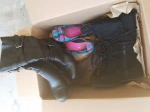 box of duplicate shoes