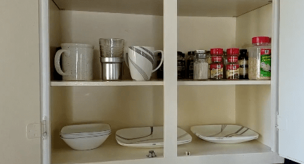minimalist kitchen cabinet with reduced number of dishes