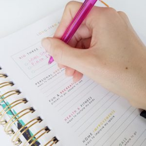 setting goals in a planner after choosing a word of the year that changes everything