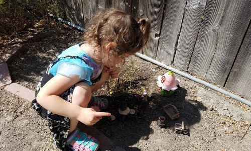 girl playing with her DIY fairy garden