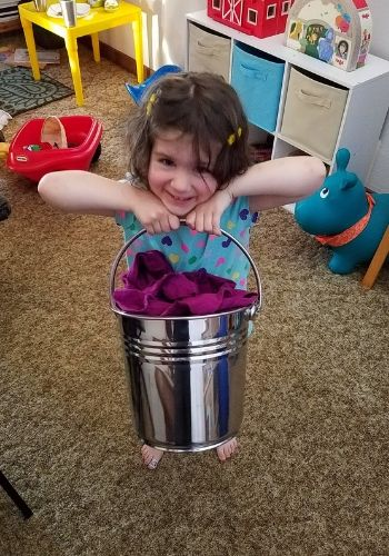 learning household skills with a stainless steel bucket